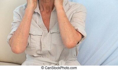 Elderly woman with a neck pain