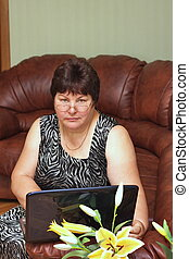 elderly woman  with a notebook