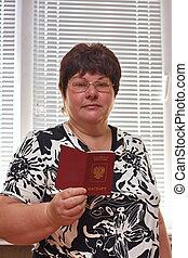 elderly woman  with a passport