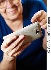 Elderly woman with a smartphone