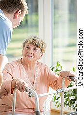 Elderly woman with a walker
