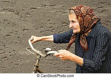 Elderly woman with bike