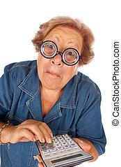 Elderly woman with calculator