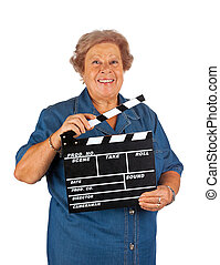 Elderly woman with clapper board