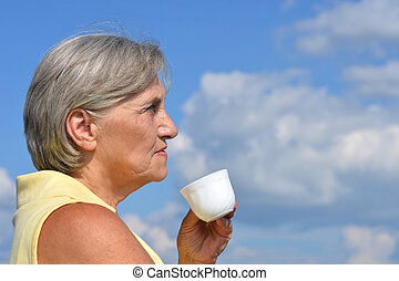 Elderly woman with cup