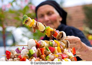 Elderly woman with fresh food