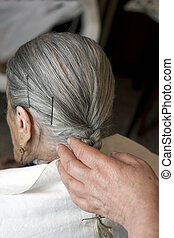 elderly woman with hairstylist