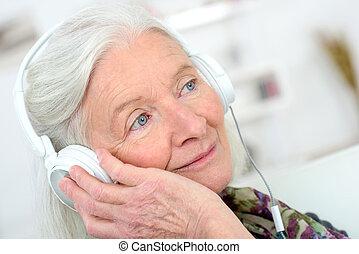 elderly woman with headphones