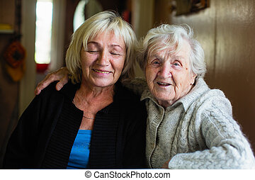 Elderly woman with her adult daughter.