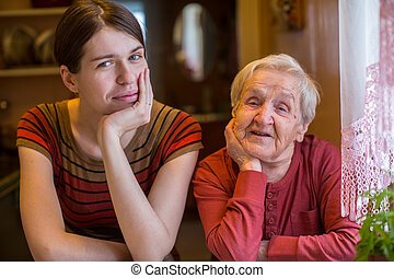 Elderly woman with her adult granddaughter