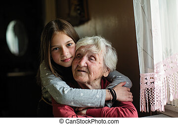 Elderly woman with her young granddaughter