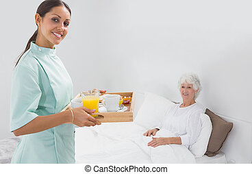 Elderly woman with home nurse