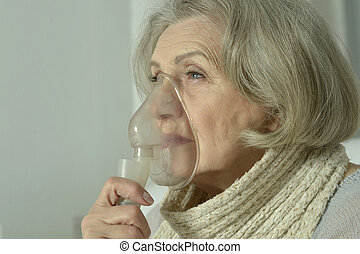 elderly woman with inhalator