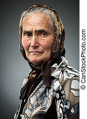 Elderly woman with kerchief, studio portrait