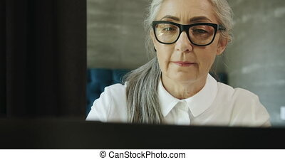 Elderly Woman with Laptop - Aged beautiful female in...