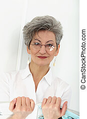 Elderly woman with magazine