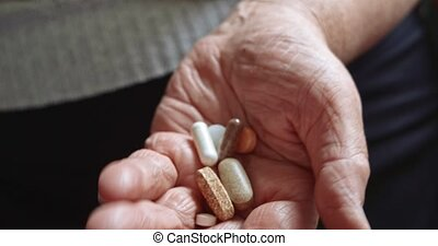 Elderly woman with medication. Old hands with medicines...