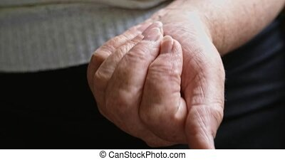 Elderly woman with medicines. Hands of an grandmother with pills.