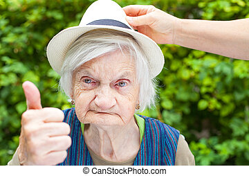 Elderly woman with mental disorder