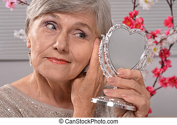 Elderly woman with mirror
