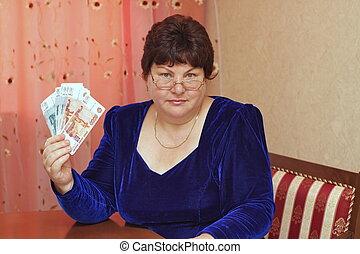 elderly woman with money in hands