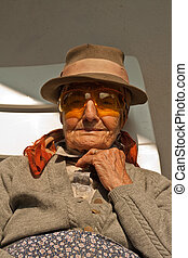 elderly woman with odd glasses