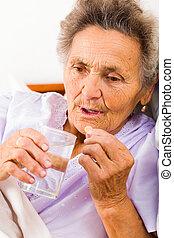 Elderly Woman with Pills