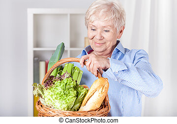 Elderly woman with shopping basket