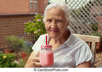 Elderly woman with smoothie