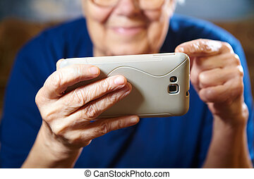 Elderly woman with tablet computer