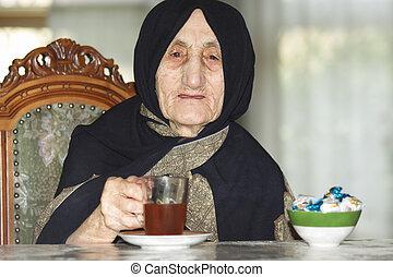 Elderly woman with tea