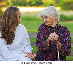 Elderly woman with the young doctor