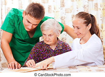 Elderly woman with the young doctors