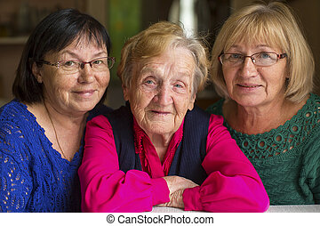Elderly woman with two adult daught