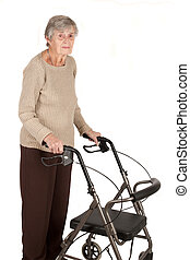 An elderly woman standing with her walker isolated on white background