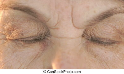 Elderly woman's face with disturbing look of face