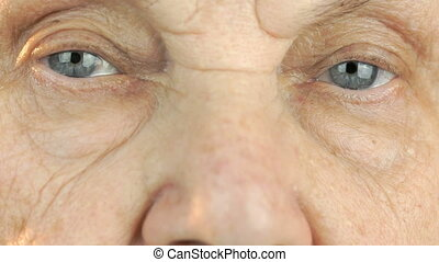Elderly woman's face with tired expression of face. Close up