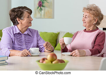 Elderly women drinking coffee