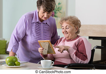 Elderly women looking at a picture