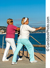 Elderly women stretching before jogging.