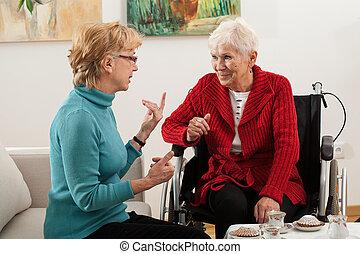 Elderly women talking - Elderly daughter visiting his...