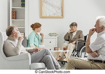 Elders and nurse meeting