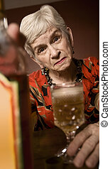 Eldery alcoholic woman - Senior woman alcoholic with a...