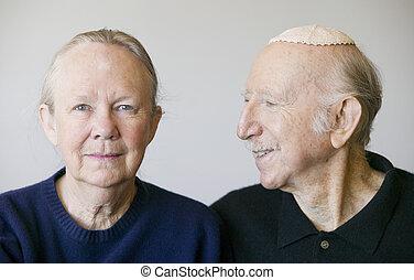 Close-up of eldery Jewish couple in studio.
