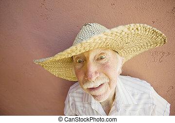 Eldery man in a straw hat