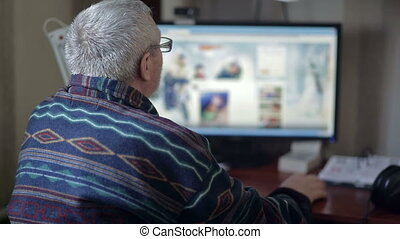 Eldery man working on a computer