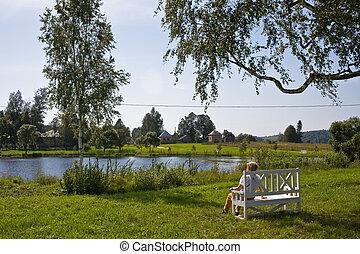Eldery woman on a bench