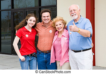 Election - Family Outside Polls - Family standing outside...