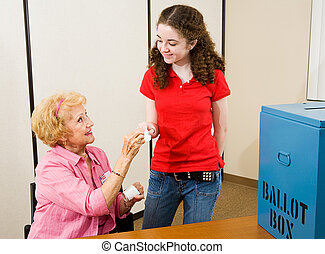 Election - First Time Voting - Senior woman giving an I...
