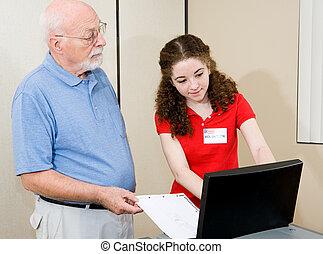 Election - Helpful Volunteer - Teen volunteer helping senior...